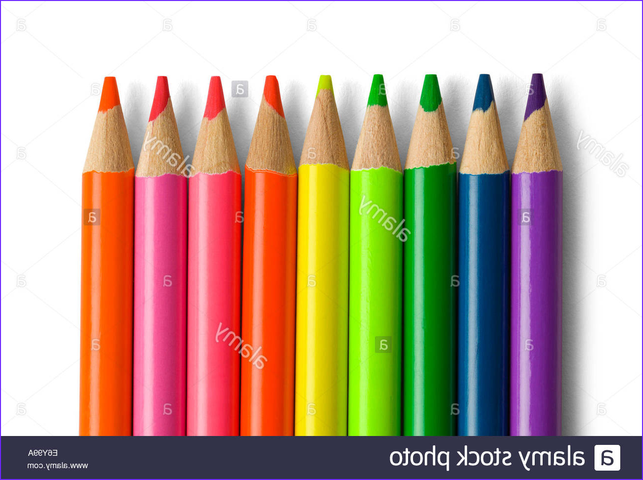 stock photo several bright colored pencils lined up isolated on white background