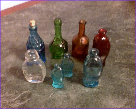small colored glass bottles
