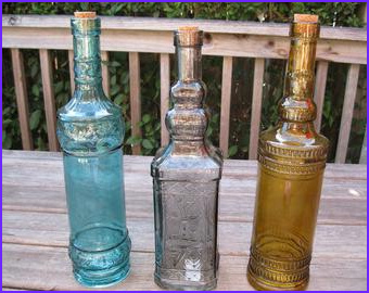 3 blue decorative colored glass bottles