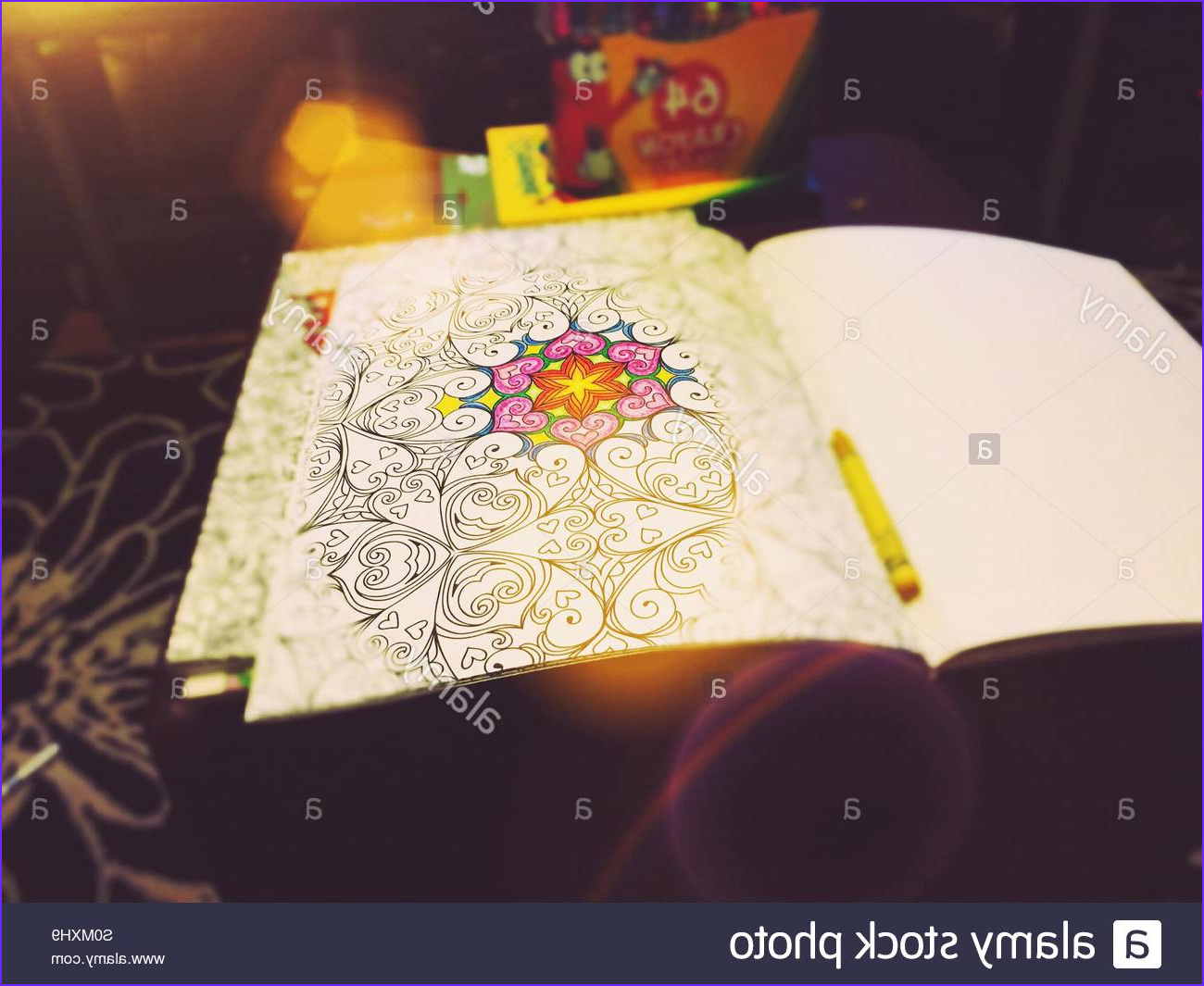 stock photo adult coloring book with crayons